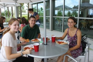 Students grab a bite to eat during a lunch break held mid-day at the Sanford-Burnham Medical Research Institute.