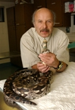 Dr. Elliott  Jacobson is shown with a snake in this file photo.