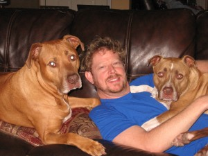 Larry Ferguson with his two pit bull terriers