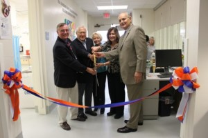 Dr. Colin Burrows, Arnold Grevior, Barbara Grevior, Dr. Natalie Isaza and Dean Hoffsis cut the ribbon.