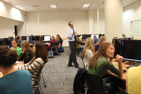 Dr. Jorge Hernandez addresses students in his epidemiology class in new computer room.