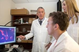 Dr. Dan Brown shows slide of mycoplasma in dog brain