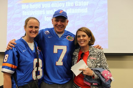 Laurie Reppas, with her husband, Dr. Greg Reppas, '08, and Dr. Pam Ginn, associate dean for students and instruction.