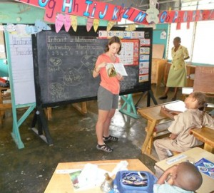 Dr. Katie Tripp reads a manatee story book to children at a school in Jamaica in 2011.