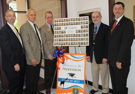 FVMA members with Dean Glen Hoffsis by sign welcoming new grads to the profession.