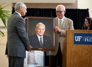 Dean Hoffsis with newly unveiled portrait.