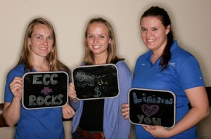UF Small Animal Hospital staffers Andrea Schultz, Amanda MacCarthy and ? made signs that reflect their jobs for the Big Picture photo shoot that was part of a UF Health campaign to promote unity among colleges, units and departments.