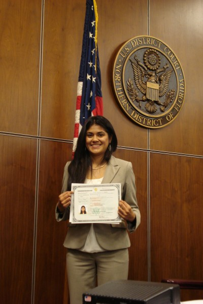 Guiliana Miranda with certificate of citizenship.