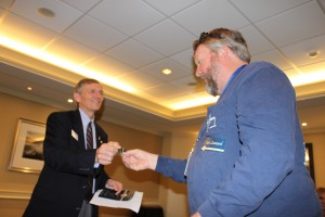 Dean James W. Lloyd presents a Dean's Circle of Excellence membership pin to Dr. Rob Leonard.