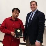 Shigeharu Tsuda holds his award.