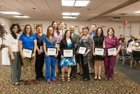 The UF College of Veterinary Medicine's 2014 UF Superior Accomplishment Awards are shown with their supervisors during a luncheon held March ? at the Paramount Hotel. From left to right are Dr. Chris Sanchez, Lian, Danielle Shmalberg, Dr. John Harvey, Holly Kitchen, David Segura, Debbie Couch, Shellie Evers, Danny Sanetz, Kia  and Dr. Amy Stone.