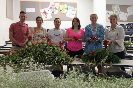Students prepare flowers for graduation