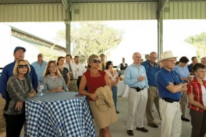 Attendees of ribbon-cutting for equine sports complex