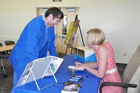 Veterinary technician Robert Reeves, left, and Dr. Sarah Boston at book signing.