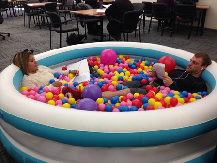 Students study in ball pit.