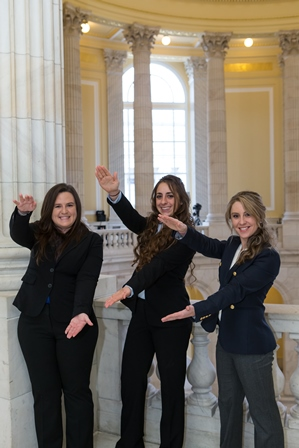 Three UF veterinary students do the chomp at AVMA Fly-in 2015