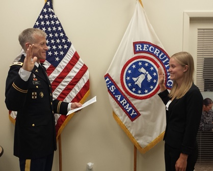 UF veterinary student Rachel Lovell is commissioned into the U.S. Army by her father at a ceremony held in early June. (Photo courtesy Sgt. Jeremiah Perez)