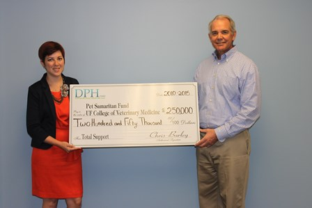 College development officer Marcela Brandao is shown with Chris Barley, an advisor to the DPH Fund. Through Barley, the DPH Fund has provided a total of $250,000 over five years to the Pet Samaritan Fund, which is reserved for special cases. Thanks to the Pet Samaritan Fund, more than 200 dogs have received life-saving treatment at the UF Small Animal Hospital. The fund is reserved for cases where acute targeted medical intervention is needed to get the animal back on its feet.