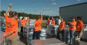 UF VETS team members celebrate with the Gator Chomp before distributing $70,000-worth of pet food to organizations assisting pet owners needing relief for their animals in the aftermath of Hurricane Matthew. (Photo courtesy of UF VETS)