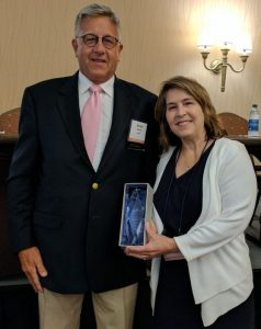 Jeff Douglas and Sarah Carey with AAVMC Award